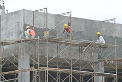 Plastering work by construction workers Stock Photo