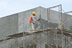 Plastering work by construction workers Royalty Free Stock Photography