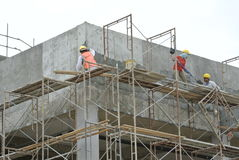 Plastering work by construction workers Stock Image