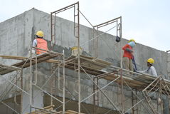 Plastering work by construction workers Stock Photography