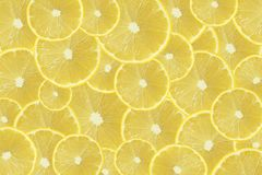 Plasterki świeży żółty cytryny tekstury tło Fotografia Stock