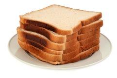 Plasterki brogujący na talerzu kanapka chleb zdjęcia stock