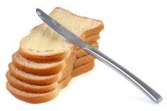 Plasterki chleb z nożem zdjęcia royalty free