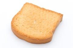 Plasterki grzanka chleb na drewnianym stole, odgórny widok zdjęcia stock