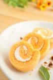 Plasterki pomarańczowy rolka tort Obrazy Stock