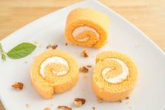 Plasterki pomarańczowy rolka tort Obraz Stock