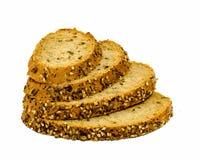 Plasterki zbożowy chleb uwalniają cięcie przy białym backround Obrazy Stock