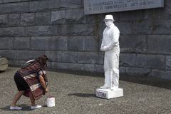 Plasterman Street Performer and Tourist Woman in Victoria BC Inner Harbour stock images