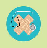 Plasters in crossed position and stethoscope flat icon Royalty Free Stock Images