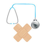 Plasters in crossed position and sthetoscope. Isolated Royalty Free Stock Photography