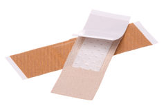 Plasters Macro Isolated. Isolated macro image first aid plasters Royalty Free Stock Image