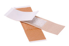 Plasters Macro Isolated. Isolated macro image first aid plasters Royalty Free Stock Images