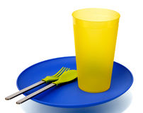 Plastic plate, cup, spoon and fork. Plastic plate, cup, spoon and fork,  on white background (with shadow Stock Images
