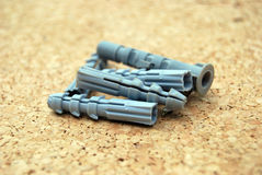 Plastic accesories for screws. Composition with  plastic accesories for screws ,objects needed in constructions Stock Image
