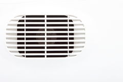 Plastic air vent in white wall ventilation grille. Close-up as background Stock Images