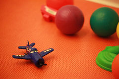 Plastic airplane model toy near balls Stock Photography