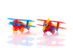 Plastic airplanes. Plastic colorful toy airplanes isolated over white royalty free stock photography