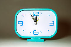, plastic alarm clock showing the time of New Year's Eve Stock Photography