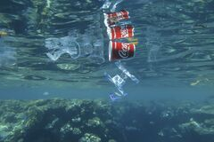 Free Plastic And Other Debris Floats Underwater Near Coral Reef. Plastic Garbage Polluting Seas And Ocean Stock Images - 200375764