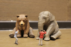 Plastic animal toy with figure people Stock Photography