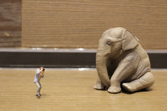Plastic animal toy with figure people Royalty Free Stock Images