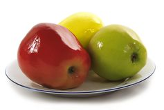 Plastic apples on a plate Stock Photo
