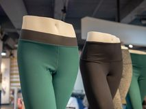 Plastic athletic mannequin lower bodies posing with yoga pants stock image