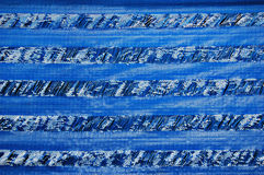 Plastic awning. Worn woven plastic fabric Royalty Free Stock Photos