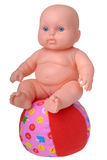 Plastic Baby Doll on the ball Royalty Free Stock Image