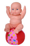 Plastic Baby Doll on the ball Royalty Free Stock Images