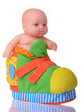 Plastic Baby Doll sitting in the colored boot Stock Photography