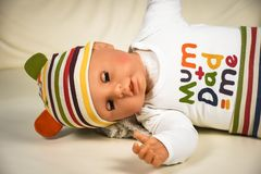 Plastic baby doll wearing funny mum plus dad me t-shirt royalty free stock images