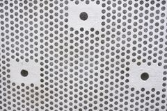Plastic background with circles, white tone, great for design. Texture with perforation of round holes. White plate with dots. Plastic background with circles royalty free stock photography