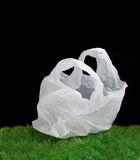 Plastic bag. A plastic bag on the green grass Royalty Free Stock Photo