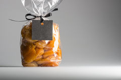 Plastic bag of apricots with blank label and copy space Stock Image
