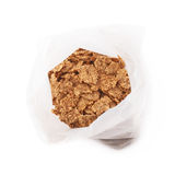 Plastic bag of cereal flakes isolated Stock Images