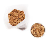 Plastic bag of cereal flakes isolated Stock Image