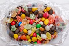 A plastic bag with colored candy. Stock Photo
