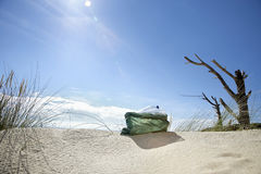 Plastic Bag Filled With Empty Bottles On Beach Stock Photography