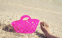 Plastic bag and foot on the sand royalty free stock photos