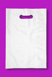 Plastic bag on fuchsia. Royalty Free Stock Photos
