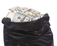 Plastic bag full of money. On white royalty free stock photos