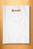 Plastic bag on gold Royalty Free Stock Photography