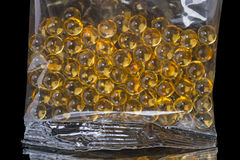 Plastic bag with granules fish oil Stock Photography