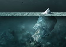 Plastic bag iceberg floating in the ocean and global warming concept. Plastic bag looking like an iceberg melting on the surface of the ocean, it is floating and stock photo