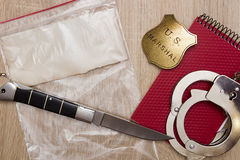 Plastic bag with a knife Stock Images
