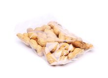 Plastic bag of peanuts on the white background Stock Photo