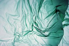 Plastic bag. Polyethylene may use as background. Template for card, poster, banner design. Green background. Space for your own royalty free stock image