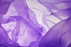 Plastic bag. Purple background for the text, textures, banners, leaflets, posters, with space for inscriptions. Violet royalty free stock photography