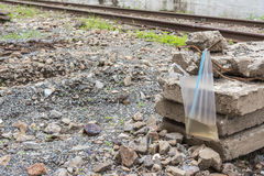 Plastic bag and rail way Royalty Free Stock Images